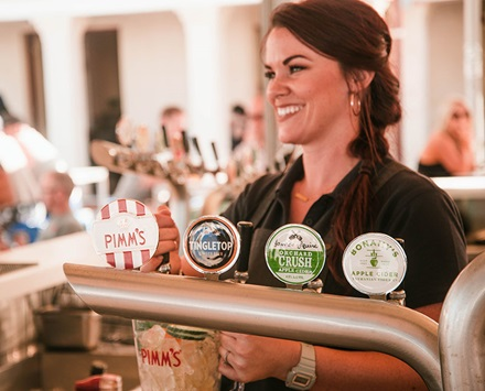 Waitress in black top serving beer at Hotel Rottnest