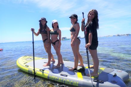 Group on paddle board from Aquaplay Rottnest