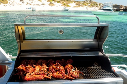 Fresh lobster being cooked on BBQ onboard boat