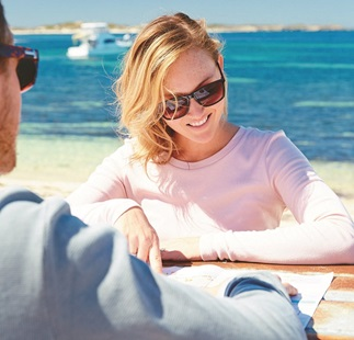 Couple planning their day with a map of Rottnest Island